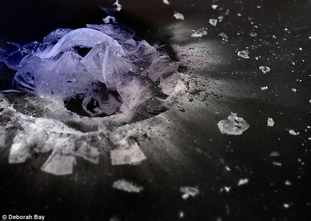 子弹高速穿透玻璃精彩瞬间:碎纹似宇宙星系
